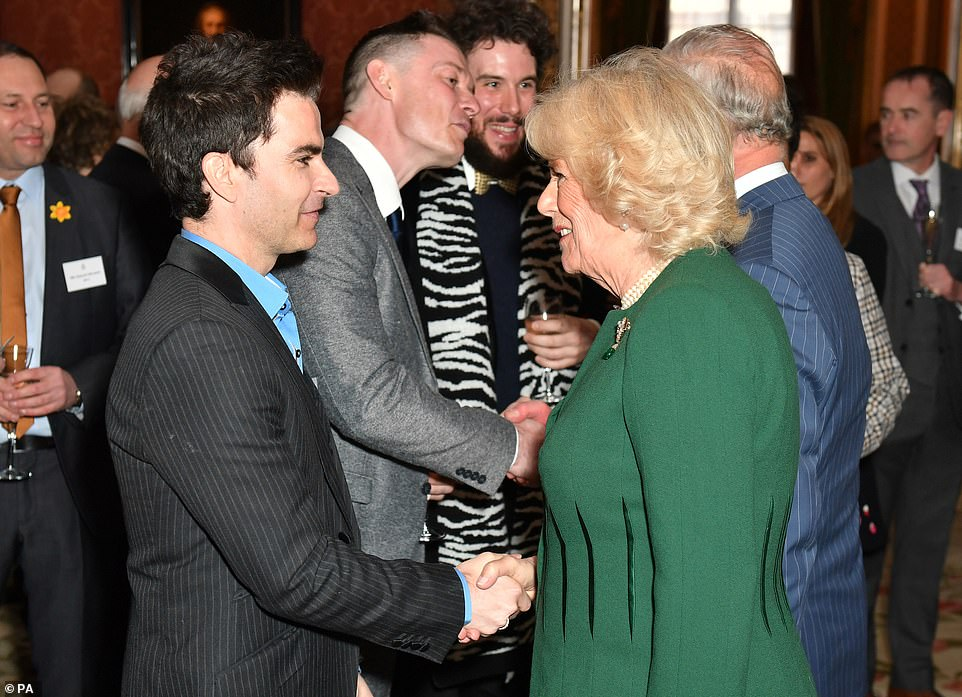 The Duchess of Cornwall was also pictured as she mingled with with Kelly Jones lead singer of the Stereophonics at the reception at Buckingham Palace