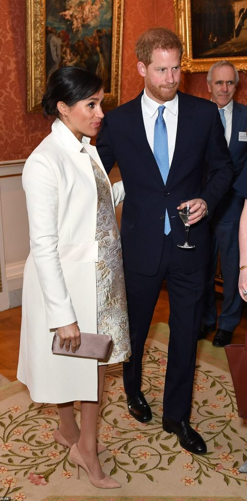 The Duchess of Sussex was pictured wearing a recycled £ Amanda Wakeley coat with a floral embellished dress as she joined Prince Harry