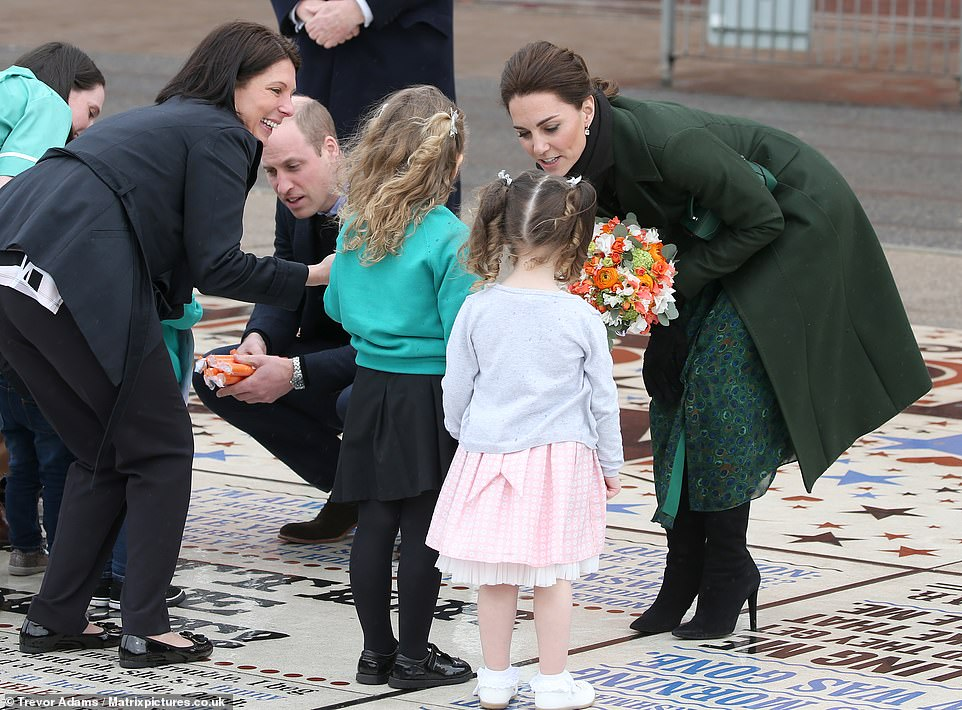 The Duke and Duchess of Cambridge were pictured speaking to children waiting in the crowds as they met members of the public on the promenade