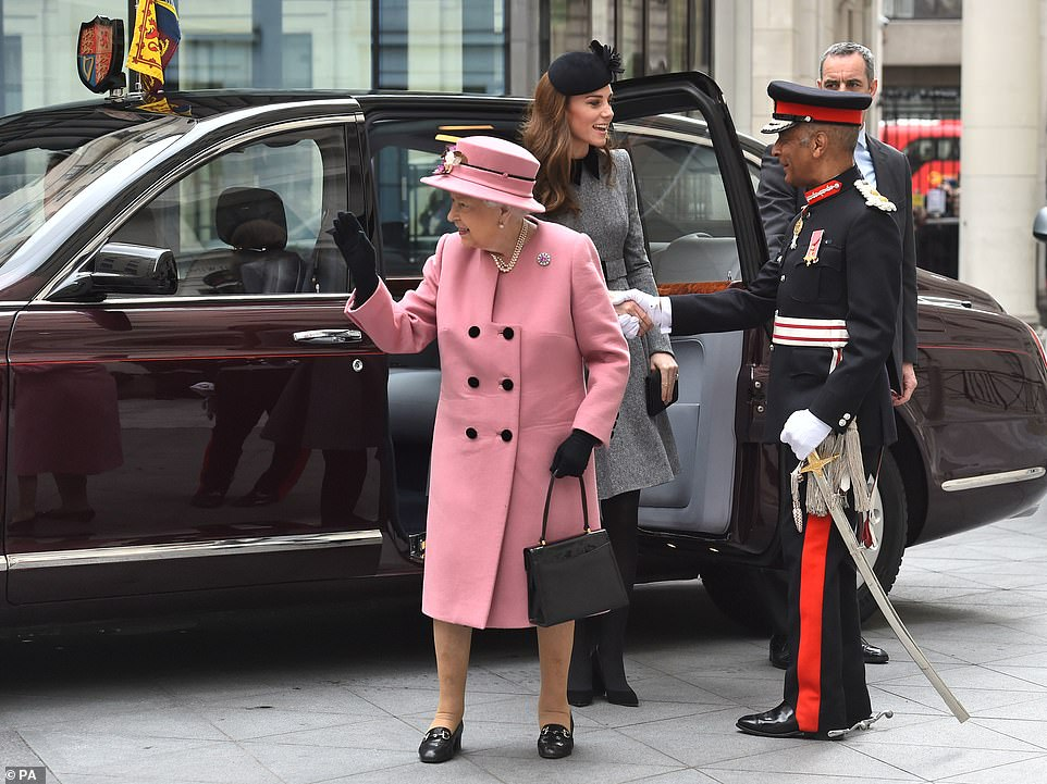 The Queen brought a splash of colour to proceedings in her pink coat and waved to royal well wishers as she arrived