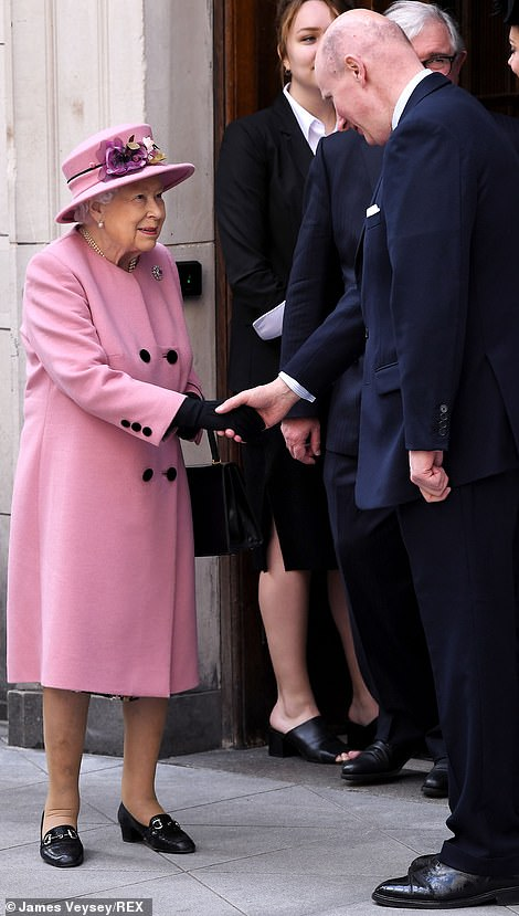 The Queen perfectly matched her outfit with her pink sapphire and diamond surround brooch as seen on her coat