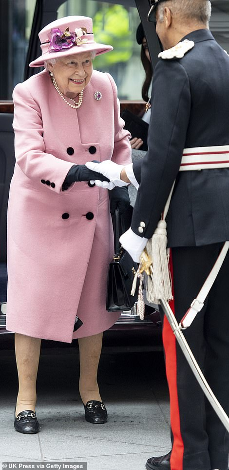 The Queen smiled as she stepped out of the car dressed in a coat by Stewart Parvin and matching Rachel Trevor Morgan hat
