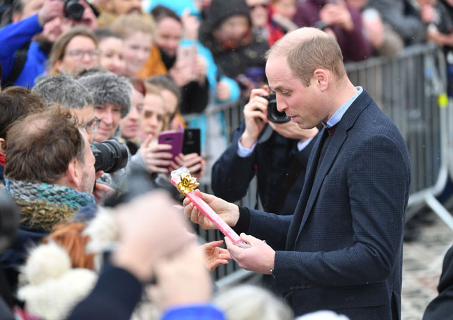 William receives the Blackpool rock gift for his children Photo C GETTY IMAGES