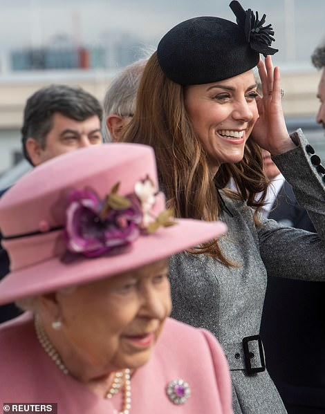 although Kate had to readjust on the blustery roof