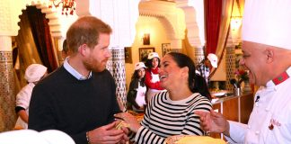 meghan laughs harry a