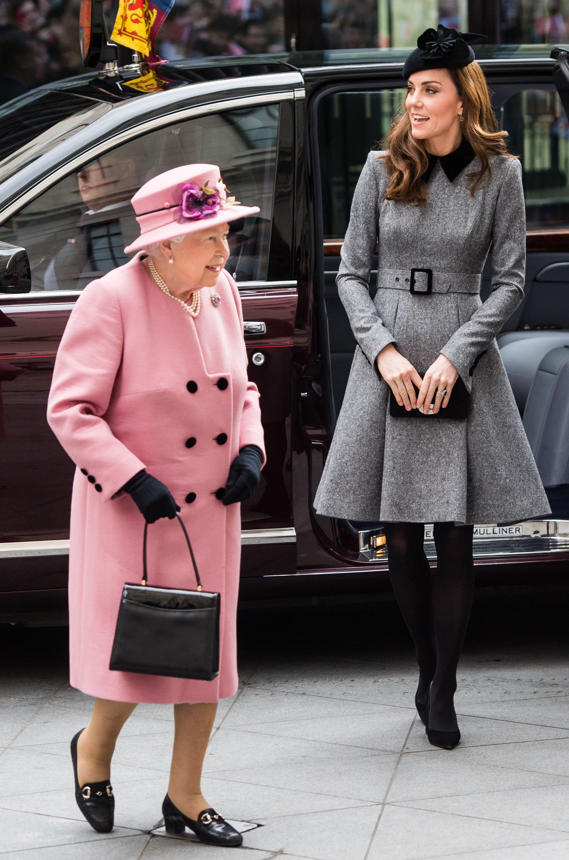 Queen Elizabeth II And The Duchess Of Cambridge Visit King