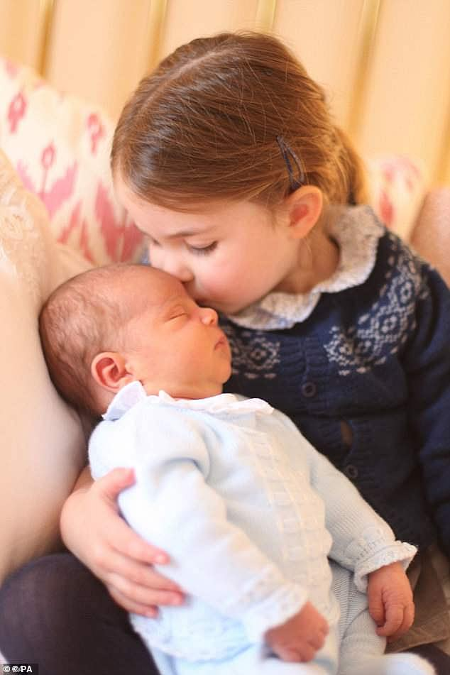 For Charlottes third birthday Kensington Palace released this sweet picture of the doting big sister holding her week old baby brother Louis