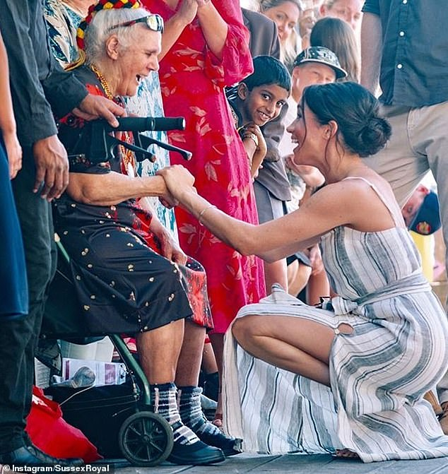 Meghan shares a light hearted moment with a well wisher during a walkabout in Sydney The image was one of three in the gallery taken on their royal tour last year