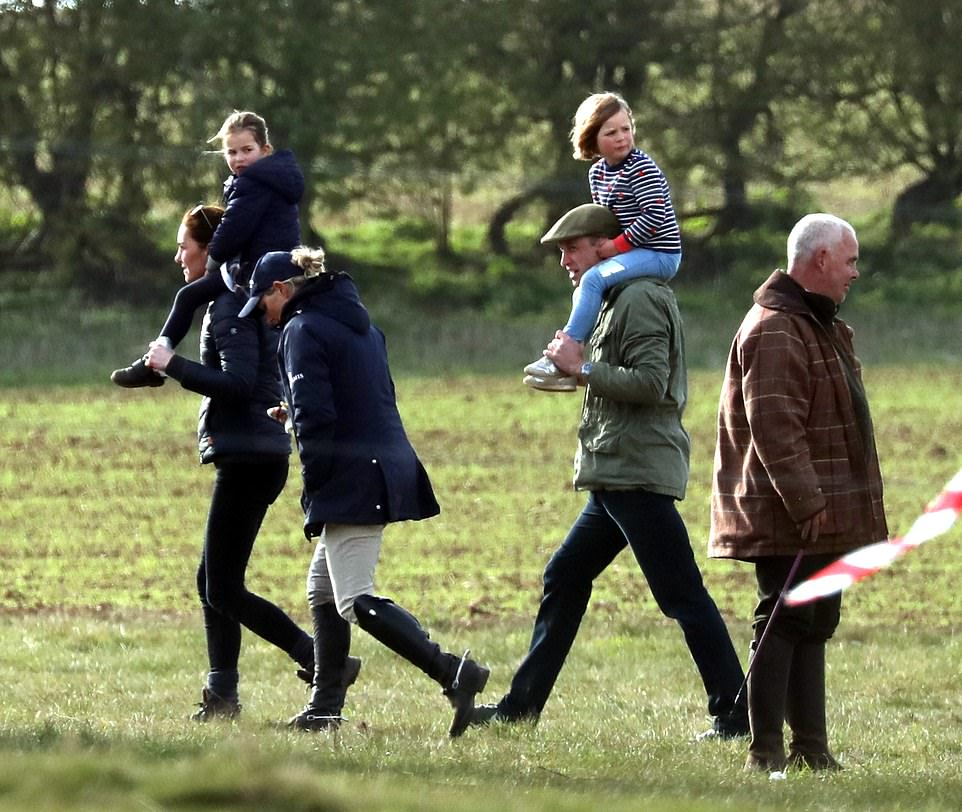 Mia Tindall was hoisted aloft by her mum's cousin Prince William centre right as she made a grab for his ears while Mia's cousin Princess Charlotte
