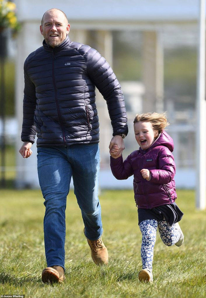 Mike Tindall runs with Mia Tindall as mum Zara Tindall competes on day two of the Barefoot Retreats Burnham Market Horse Trials