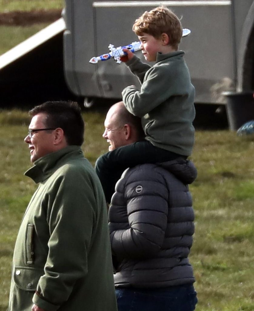 Prince George was also involved in the family day out and found a perch on the generous shoulders of his uncle Mike Tindall Zara's husband