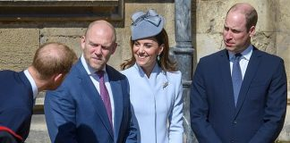 Prince Harry leans over to exchange a few words with Mike Tindall Kate and William as they await the Queens arrival