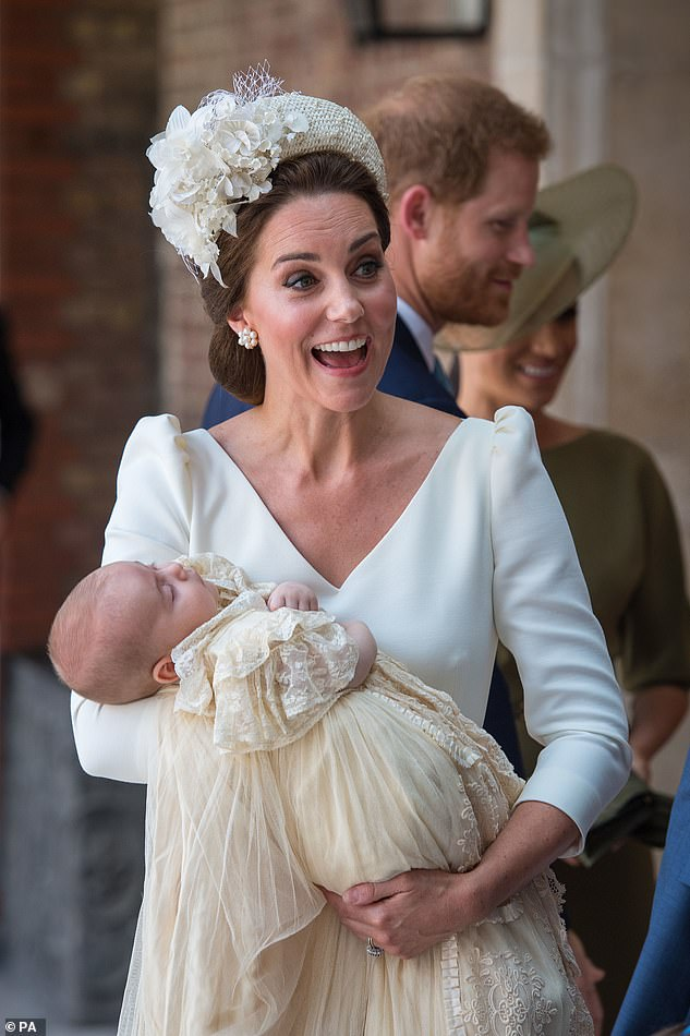 Prince Louis pictured being held by his mother sweetly slept through his christening service at the Chapel Royal St Jamess Palace in July last year