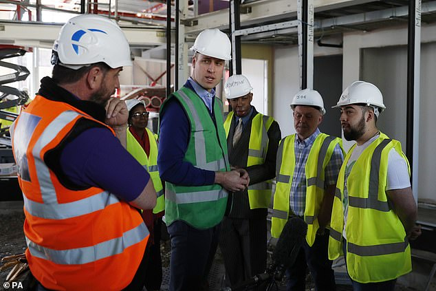 Prince William joined the DIY SOS builders in Ladbroke Grove West London as they worked on a major project to support families affected by the devastating fire at Grenfell Tower