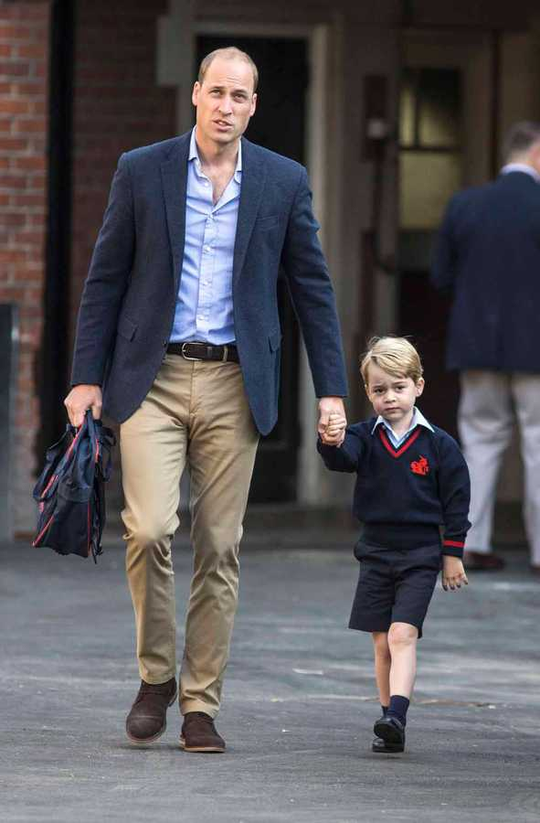 Prince William with his son Prince George photo C Getty Imgaes