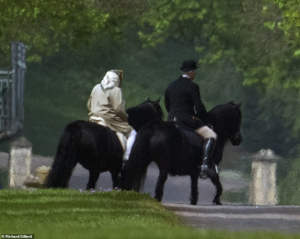 The Queen who turned yesterday rode her horse western style while being accompanied by a courtier around the grounds of Windsor Castle