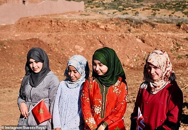 This image shows girls waiting to catch a glimpse of the royals during their visit to Morocco