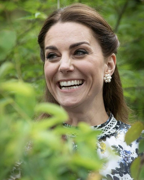 A royal expert has claimed the public kiss means the Queen has given Kate her highest approval Image GETTY