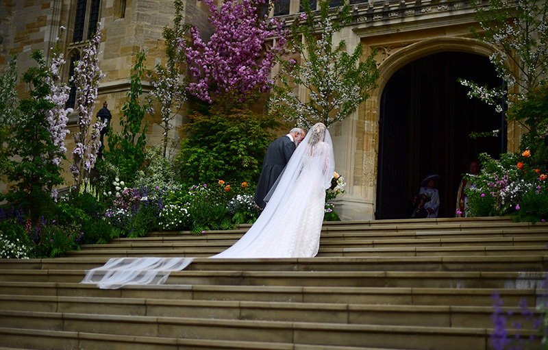 A view of Lady Gabriellas beautiful bridal train from the steps of St Georges Chapel in Windsor Photo C iimage
