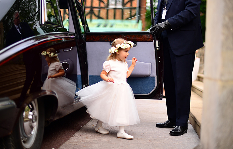 A young bridesmaid smiles with excitement as she prepares for her role in the bridal party Photo C iimage