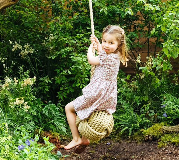 Kate Middleton Chelsea Flower Show Princess Charlotte was pictured on the rope swing in the garden Image KENSINGTON PALACE