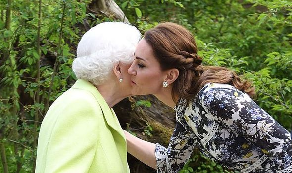 Kate gave the Queen a kiss on both her cheeks at the Chelsea Flower Show to the shock of royal fans Image IMAGES