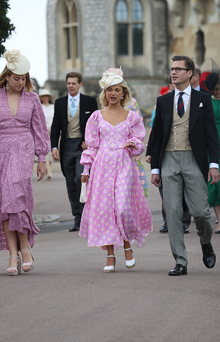 Lady Amelia Windsor wore a beautiful pink midi dress with white wedges and a matching clutch bag Photo C iimage