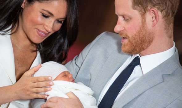 Meghan Markle holds baby Archies head as Prince Harry looks on Image GETTY