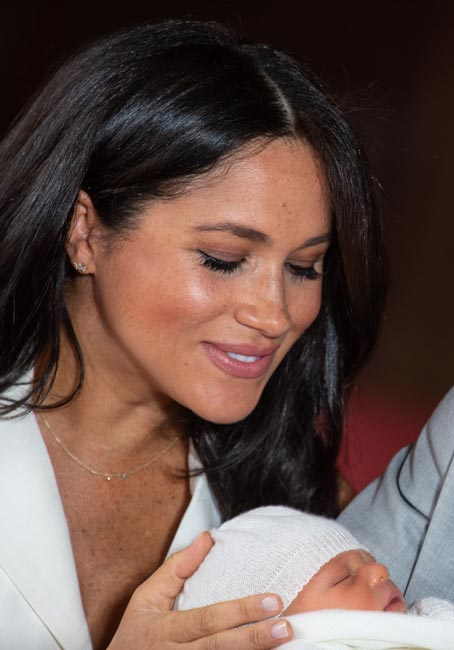Meghan looks at baby Archie as Harry holds him Phto C Gett Images