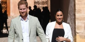 Prince Harry Duke of Sussex and Meghan Duchess of Sussex walk through the walled public Andalusian Image GETTY