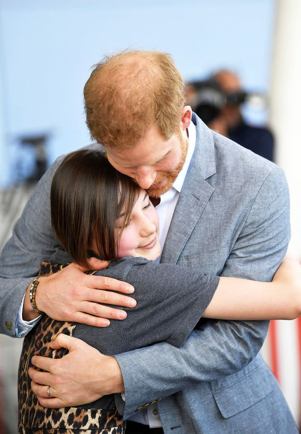 Prince Harry hugs former patient Daisy Wingrove