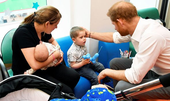 Prince Harry speaking with a patient at Oxford Children