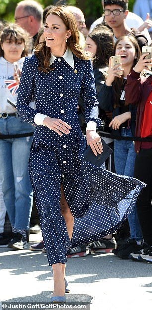 Royal blue Kate plumped for head to toe blue and paired the frock with a pair of £ suede court shoes by Emmy London and a £ navy Panama Purse by Smythson