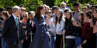 Stepping into spring Kate greeting crowds in the flattering mid length dress yesterday