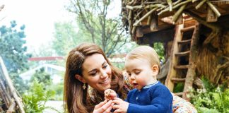 The Duchess of Cambridge with her youngest child Prince Louis in her Chelsea Flower Show garden Photo Matt Porteous