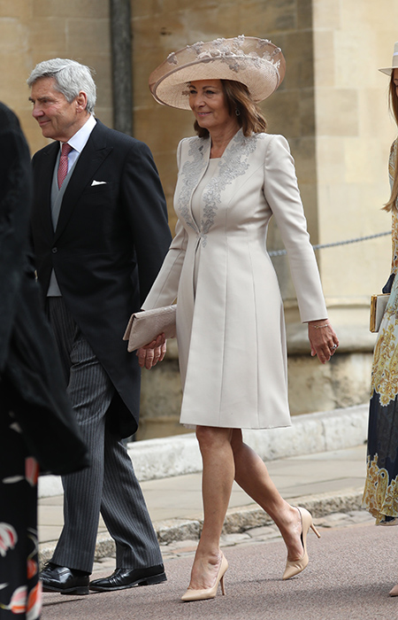 The Duchess of Cambridges mother Carol Middleton arrived looking stunning in a dress coat and matching hat Photo C iimage