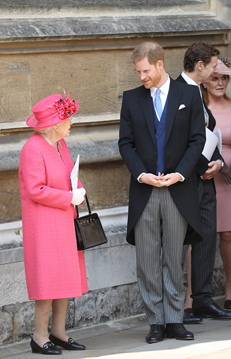 The Queen and Prince Harry share a moment together outside the chapel Photo C iimage