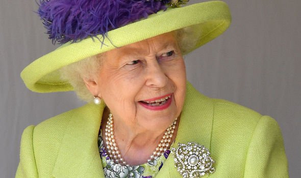 The Queen wearing her pearl earrings known as Queen Mary's Button Earrings Image GETTY