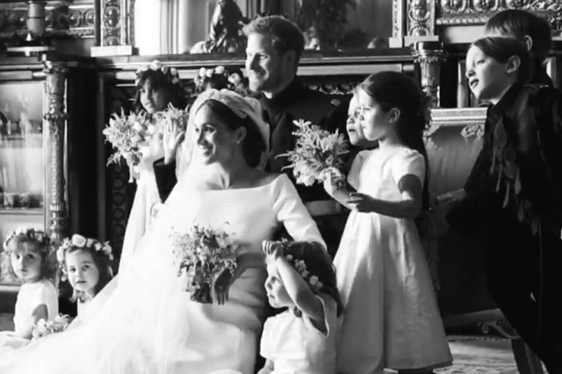 The adorable four year old is pictured in a never seen before picture from Harry and Meghans wedding Image sussexroyal Chris Allerton