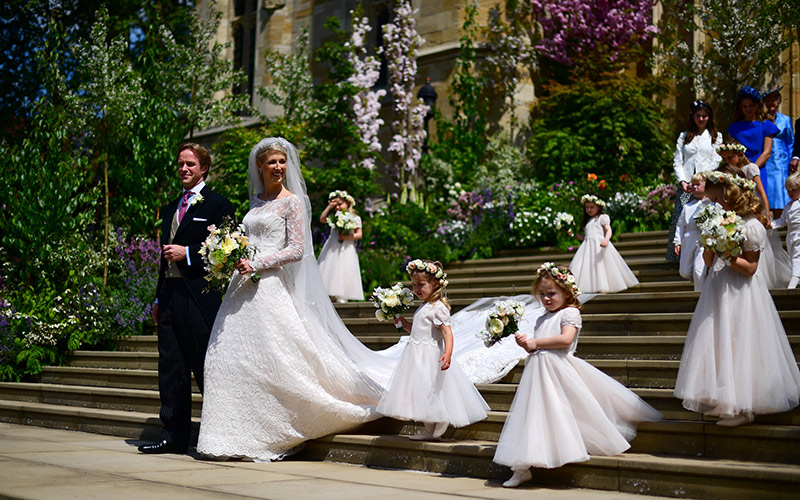 The bridal party make their way down the steps from St Georges Chapel following the ceremony Photo C iimage
