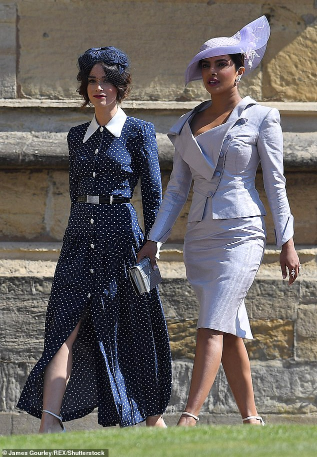 The dress was notably seen on Meghans friend and former Suits co star Abigail Spencer at the Sussexes wedding in May last year pictured with Priyanka Chopra