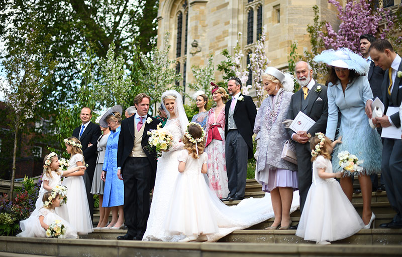 The wedding party pose for photographers on the steps of St Georges Chapel Photo C iimage