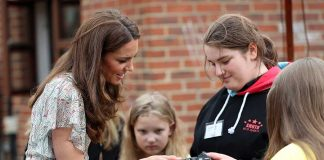 Kate Middleton is all smiles at photography workshop after picking up new patronage Photo C GETTY IMAGES