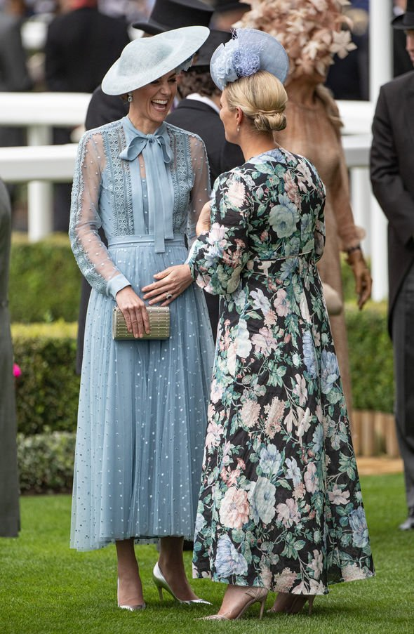 Kate Middleton pregnant Kate held her tummy as she laughed with Zara Image GETTY