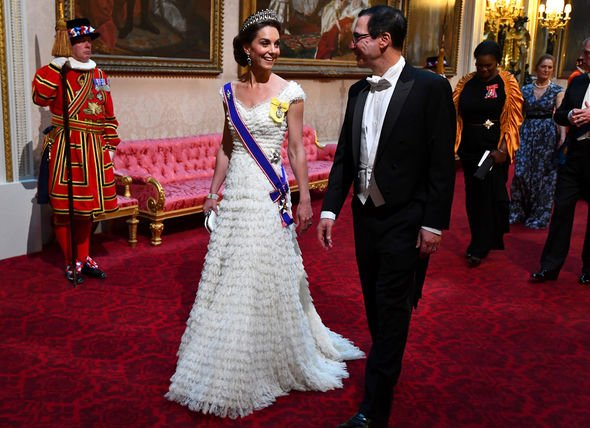 Kate the Duchess of Cambridge in a white gown designed by Alexander McQueen Image GETTY