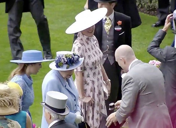 Mike Tindall amuses the royals with a tiny topper Image ITV Racing