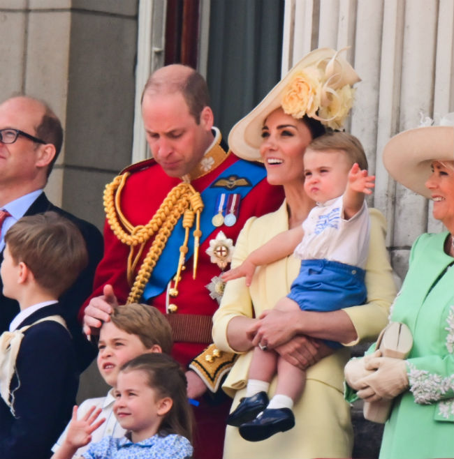 Prince Louis enthusiastically waved nearly knocking the Duchess of Cornwalls hat off Photo C Getty Images