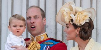 Prince Louis looked at the flypast from the arms of Prince William Image GETTY