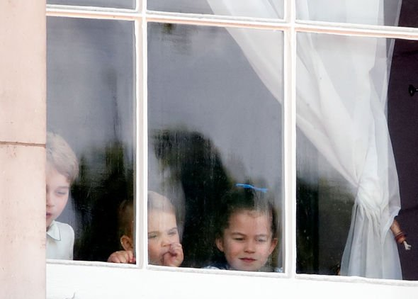 Prince Louis pictures Prince George Princess Charlotte and Prince Louis peered from a window Image GETTY