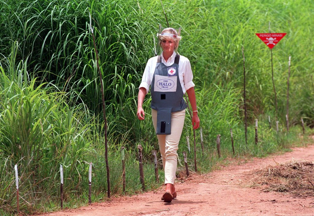 Princess Diana walks on the edge of a minefield in Angola in Photo PA